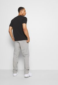 Champion - LEGACY STRAIGHT HEM PANTS - Joggebukse - mottled grey