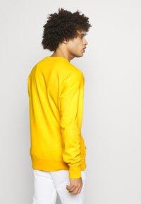 Champion - Sweatshirt - yellow - 2