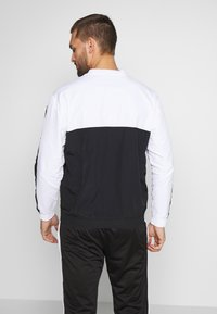 Champion - ROCHESTER ATHLEISURE - Sudadera - black/white - 2