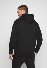 Champion - TAPE HOODED - Mikina s kapucí - black - 2