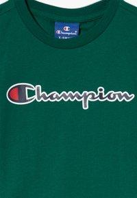 Champion - ROCHESTER LOGO CREWNECK - Print T-shirt - dark green - 3