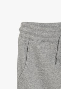 Champion - AMERICAN CLASSICS CUFF PANTS - Tracksuit bottoms - mottled grey - 4