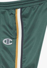Champion - ROCHESTER VARSITY HALF BUTTON PANT - Tracksuit bottoms - dark green - 4