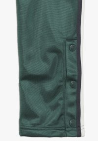 Champion - ROCHESTER VARSITY HALF BUTTON PANT - Tracksuit bottoms - dark green - 2