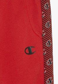 Champion - CHAMPION X ZALANDO PANT - Verryttelyhousut - red/white - 3