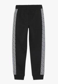 Champion - CHAMPION X ZALANDO PANT - Pantalon de survêtement - black/white - 1
