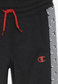 Champion - CHAMPION X ZALANDO PANT - Pantalon de survêtement - black/white - 4