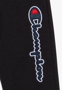 Champion - LOGO RIB CUFF  - Spodnie treningowe - black - 2
