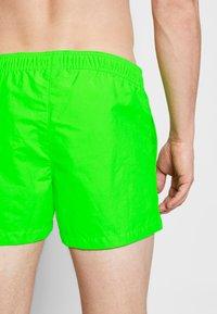 Champion - BEACHSHORT LEGACY - Swimming shorts - neon green - 1