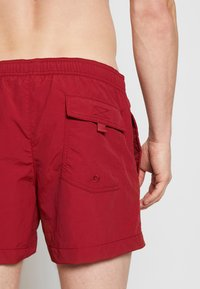 Champion - BEACHSHORT LEGACY - Shorts da mare - dark red - 1
