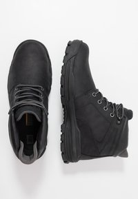 Cat Footwear - COHESION ICE WP - Lace-up ankle boots - black - 1