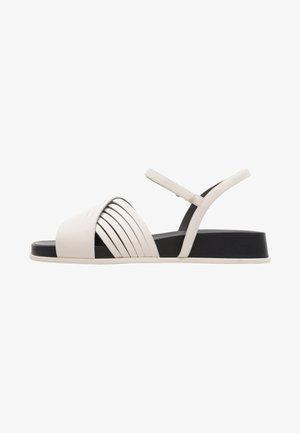 ATONIK - Sandalen met sleehak - beige