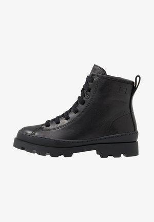 BRUTUS KIDS - Šněrovací kotníkové boty - black