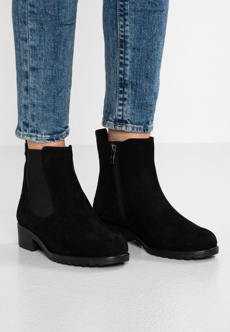 Caprice - Kotníkové boty - black