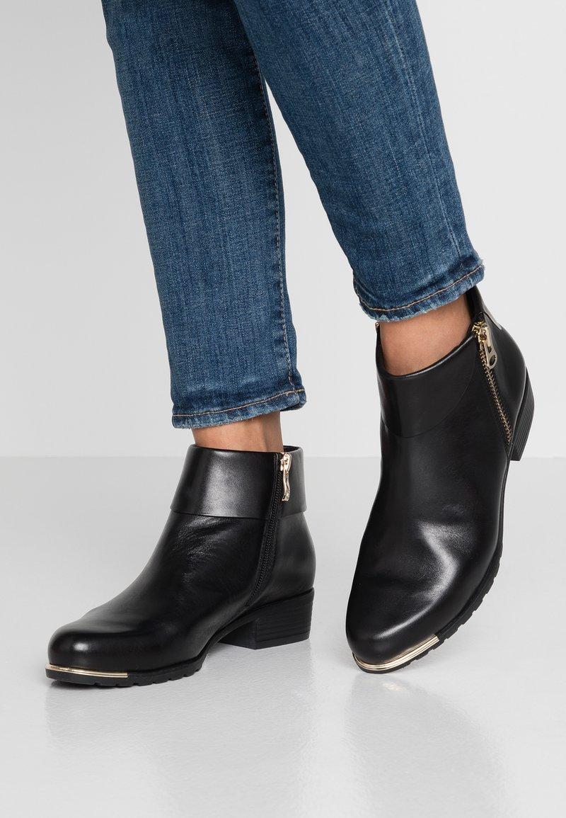 Caprice - Kotníková obuv - black