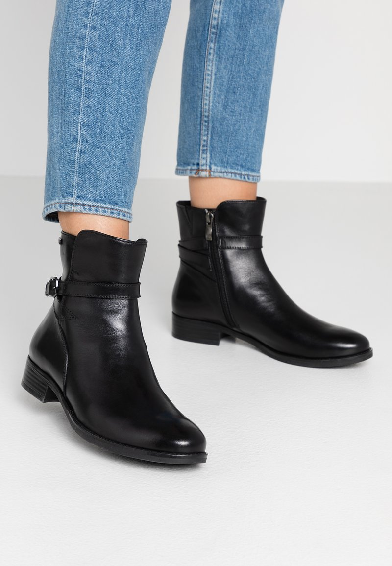 Caprice - Classic ankle boots - black