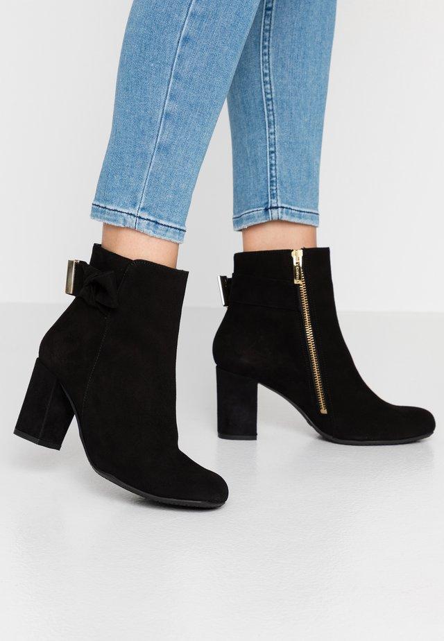 RHONA - Kotníkové boty - black