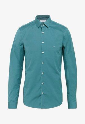 CONTRAST FLOWER PRINT SLIM - Camicia elegante - blue