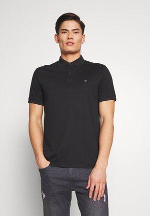 SOFT INTERLOCK SLIM - Polo shirt - black