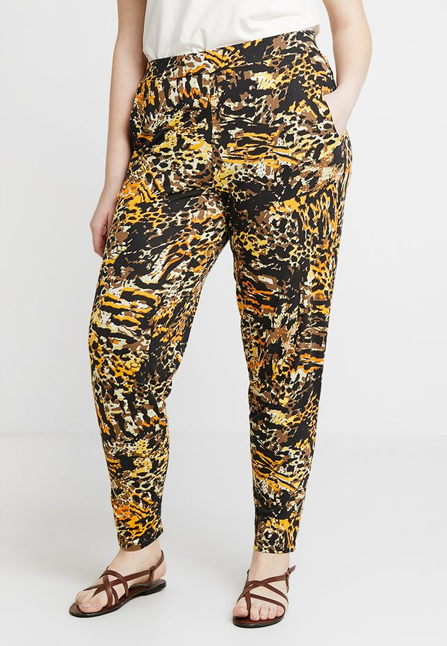 TAPERED TROUSERS ANIMAL PRINT - Trousers - brown/green
