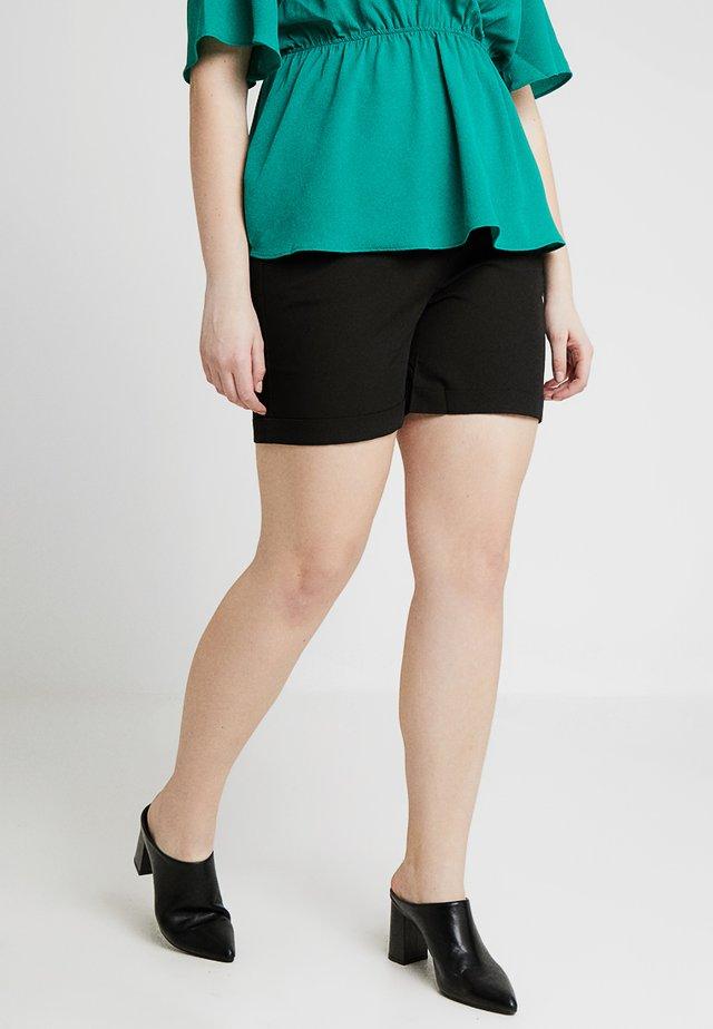 CITY - Shorts - black