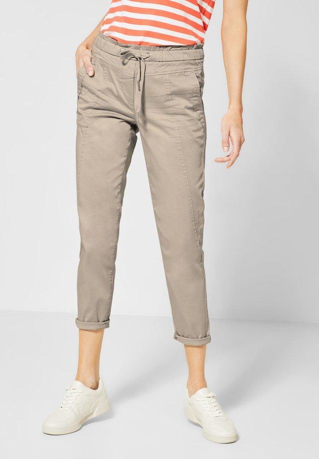 CHELSEA - Trousers - beige
