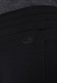 Icebreaker - CRUSH PANTS - Pantalon de survêtement - black - 4