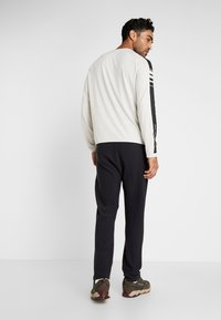 Icebreaker - TABI REAL PANTS - Tracksuit bottoms - deep midnight - 2