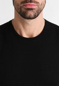 Icebreaker - ANATOMICA - Basic T-shirt - black/monsoon - 3