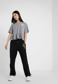 Opening Ceremony - Tracksuit bottoms - black - 1