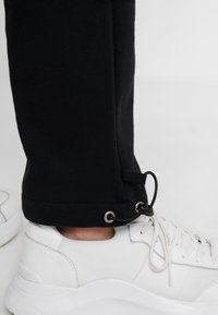 Opening Ceremony - Tracksuit bottoms - black - 4