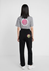 Opening Ceremony - Tracksuit bottoms - black - 2