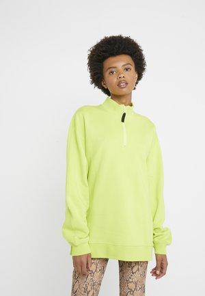 UNISEX BACK ZIP - Sweatshirt - fluorescent yellow