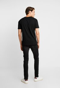CELIO - FOSLOIR - Slim fit jeans - noir - 2