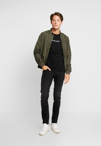 CELIO - FOSLOIR - Slim fit jeans - noir - 1