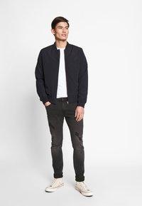 CELIO - ROSTROY - Slim fit jeans - noir - 1