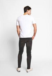 CELIO - ROSTROY - Slim fit jeans - noir - 2