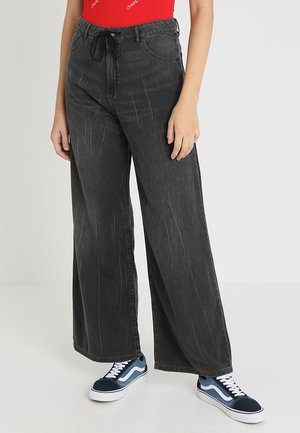 IDEAL TROUSERS - Flared Jeans - crinkle black