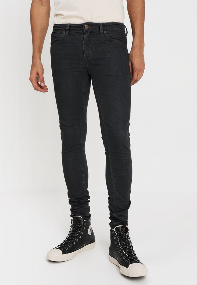 HIM SPRAY - Jeans Skinny Fit - black denim
