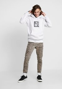 Cheap Monday - TIGHT - Jeans slim fit - cheetah sand - 1