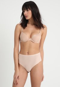 Chantelle - SOFTSTRETCH - String - beige doré - 1