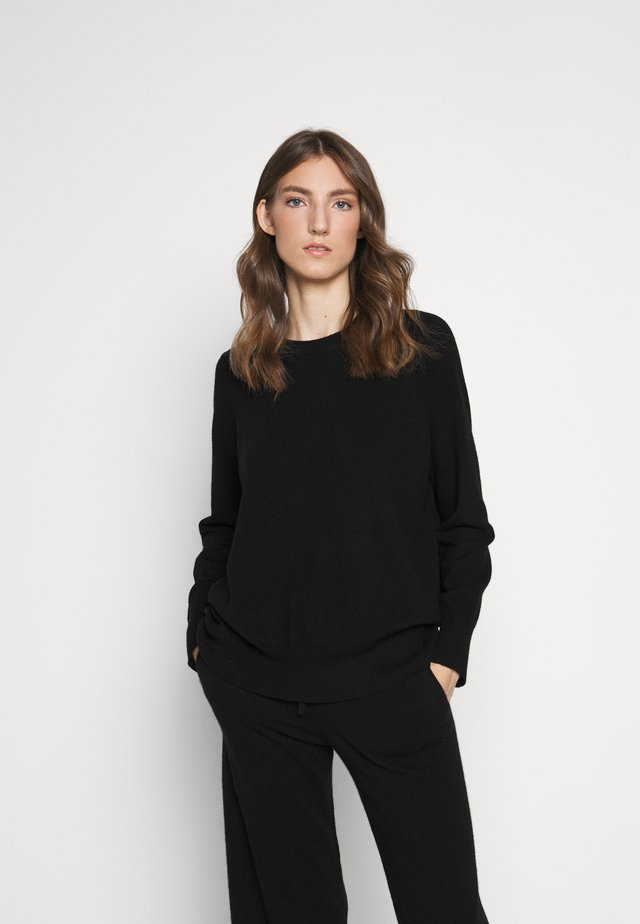 THE SLOUCHY - Stickad tröja - black