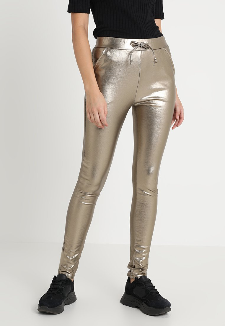 Circle of Trust - ROBYN - Tracksuit bottoms - gold metallic