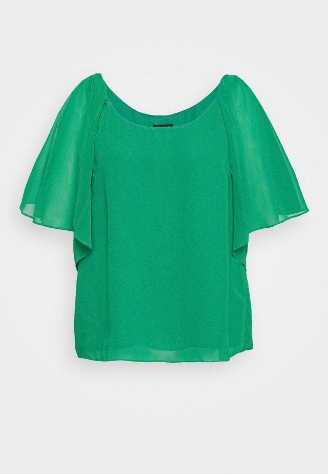 Bluse - green stone