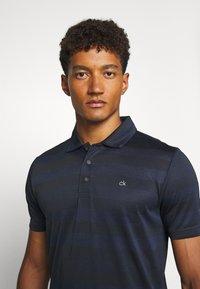 Calvin Klein Golf - SHADOW STRIPE - Funkční triko - navy - 3