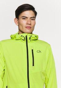 Calvin Klein Golf - ULTRA LITE JACKET - Sportovní bunda - lime - 3