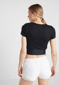 Calvin Klein Performance - CROPPED SHORT SLEEVE TEE - T-shirt print - black - 2