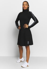Calvin Klein Performance - LONG SLEEVE DRESS - Vestido ligero - black - 1
