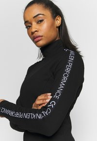 Calvin Klein Performance - LONG SLEEVE DRESS - Vestido ligero - black - 3