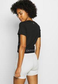 Calvin Klein Performance - CROPPED SHORT SLEEVE - Print T-shirt - black - 2
